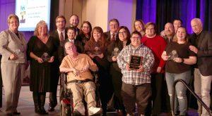 Advocacy Award winners, OK AIM service award recipients, Lifetime Achievement Award recipient James Meadours and keynote speaker Joey Travolta